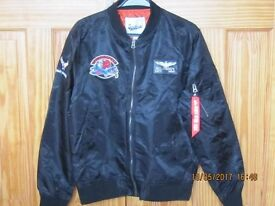 """Men's Black Bomber Jacket fits chest 44"""". Emblems on back / front / sleeves. (See pics) Never worn."""