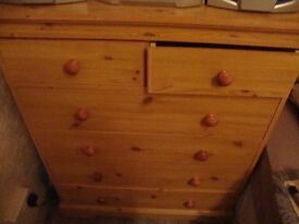 5 drawer antique pine coloured drawrs in wheels 2 half drawers at the top