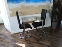 Immaculate IKEA glass and chrome dining table and 4 chairs