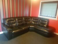 Used black leather 2 part corner sofa