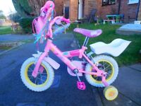Pepper Pig first bike with stabilisers
