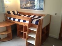 high sleeper bed (single) with integral bookcase, chest of draws and extendable work desk.