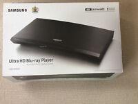 Samsung Ultra HD Blu-ray Player UBD-K8500 4K player with three 4K discs.