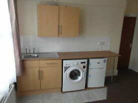 NEWLY DECORATED BEDSIT WITH OWN KITCHEN AND WASHING MACHINE