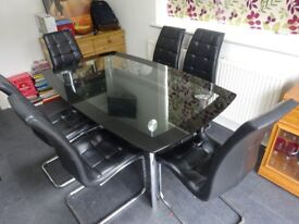 Glass dining table and 6 faux leather chair set £40