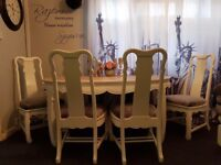 Very solid dinning table and 4 chairs... handmade paint...seller refurbished...white