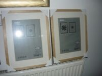 three light wood picture frames