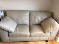 Comfortable light grey leather two seater sofa.