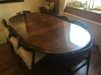 Large Oval Dark Wood Dining table with 8 chairs