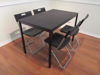 IKEA black dining table with 4 folding chairs for sale in Bedminster - collection only