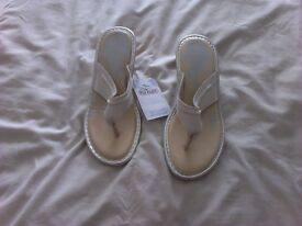 Ladies brand new Fly flot leather wedged heel sandals.White with diamonte trim.Size 6