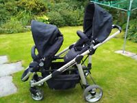Double Trouble Twin Pram with 2 carry cots and 2 rain covers