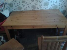 solid wooden table with 4 chairs to match