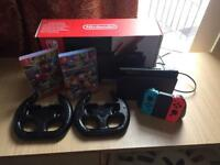 Nintendo Switch with 2 games and 2 steering wheels