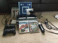 PLAYSTATION 3 -11 games, motion controller, wonderbook, two controllers and PlayStation camera 60GB