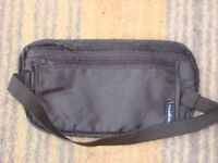 Brand new bum bag with elasticated strap.