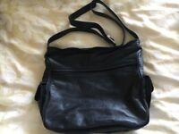 Soft navy leather shoulder bag with velvet interior by Tula