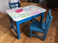 Child's wooden table and chairs.