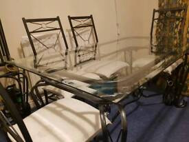 IRON & GLASS DINING ROOM TABLE AND 6 CHAIRS
