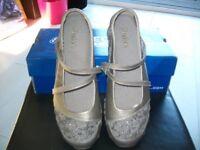 ladies skechers silver shoes