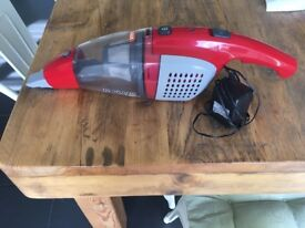 Vax hand held vacuum cleaner with plug in charger
