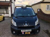 Black Peugeot E7 Taxi for sale .