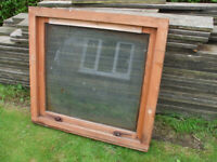wooden hardwood window frame with glass, used and in good condition