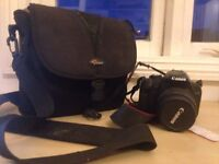 Digital SLR: Canon EOS Rebel T1i (15 MP) with 2 lenses (18-35mm and 50-250mm) and carrier bag