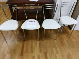 4 cream leather and metal chairs