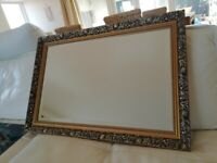 Ornate gilt-edged mirror. Large framed antique design mirror: bronze edging