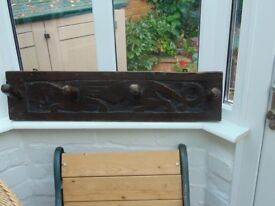 Antique solid oak coat rack with bas relief scupted lion