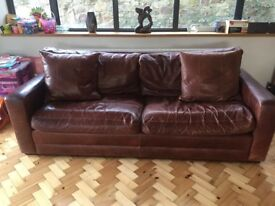 Lovely large brown real leather sofa. Great condition, needs new home.