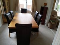 World of Furniture. New wood table and 6 Leather Chairs