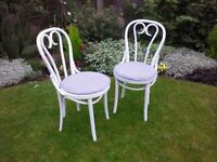 Pair of white bentwood dining chairs including custom made seat pads
