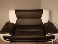 £300 black and white leather sofas