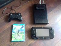 Wii U with original game pad, additional controller and Zelda Breath of the Wild