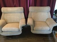 Pair of comfy high back swivel armchairs