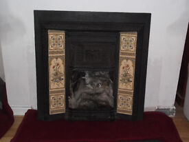 Victorian style cast iron fireplace surround with traditional style tiles. Good condition.