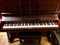 John Brinsmead upright piano.