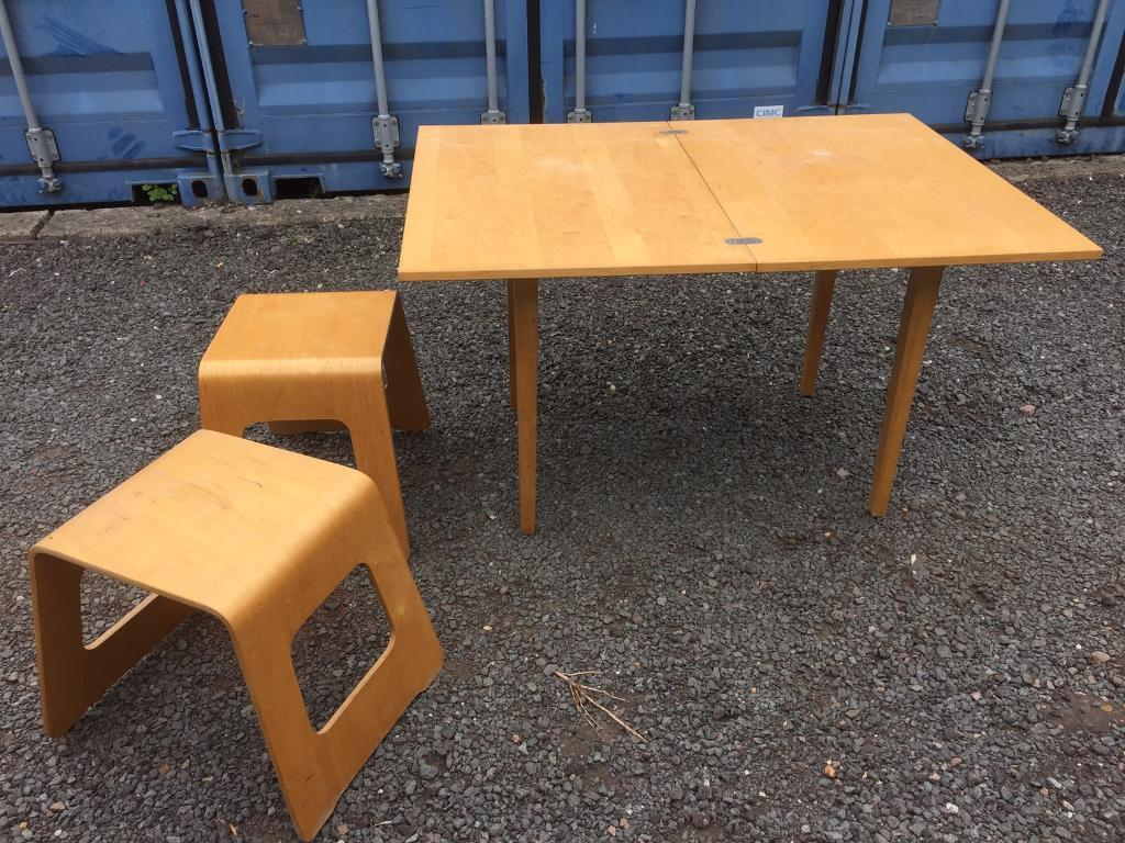 Small extendable dining/kitchen tablein Somersham, CambridgeshireGumtree - Small extendable table with two stools, originally from IKEA. Would suit for small dining room or as a kitchen table, ideal for somebody moving into their first home! Its has a few scuffs but otherwise it is a lovely little table