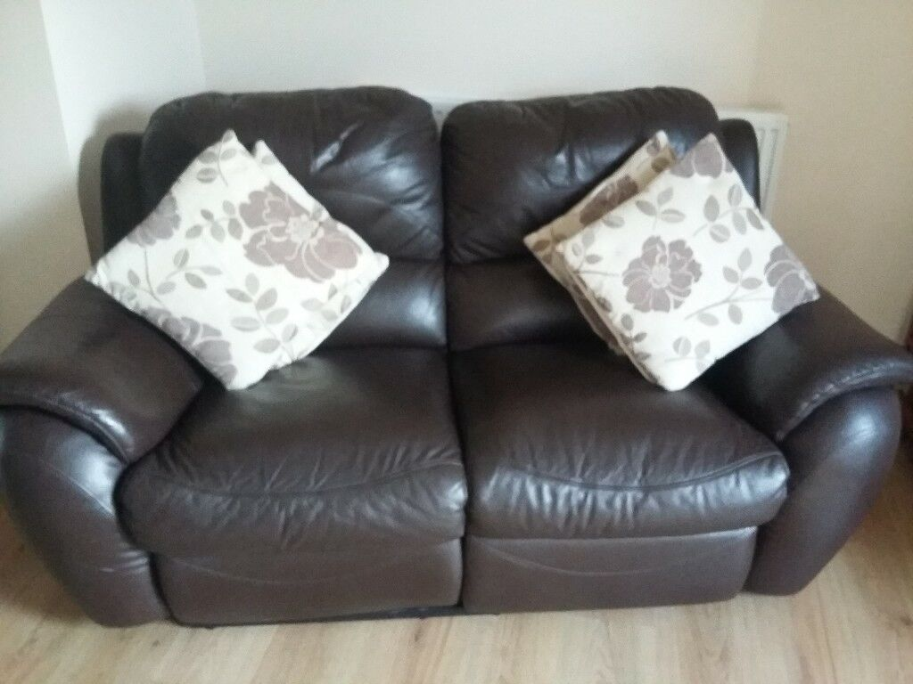 brown leather reclining sofa and a chair