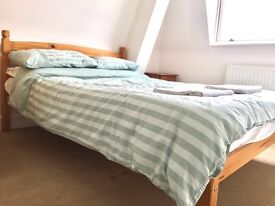 Wooden double bed and mattress in excellent condition