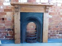 Beautiful cast iron fireplace with character wooden mantelpiece