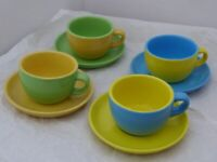 Set of four bright and cheerful Harlequin Demitasse Expresso Coffee Cups and Saucers.