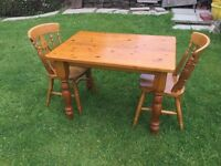 Farm house pine table and two chairs