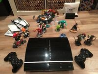 PS3 console with 30 games, 2 controllers, Disney infinity and skylanders portals