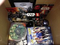 Box of Star Wars toys and DVDs