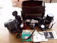 Minolta SR-T 101 camera with cases lenses, filter, etc