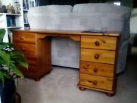 Solid pine dressing table with eight drawers. In good condition.