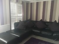 Black leather 5 seater corner sofa with foot stall